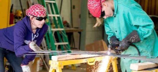 Women Using an acetylene torch